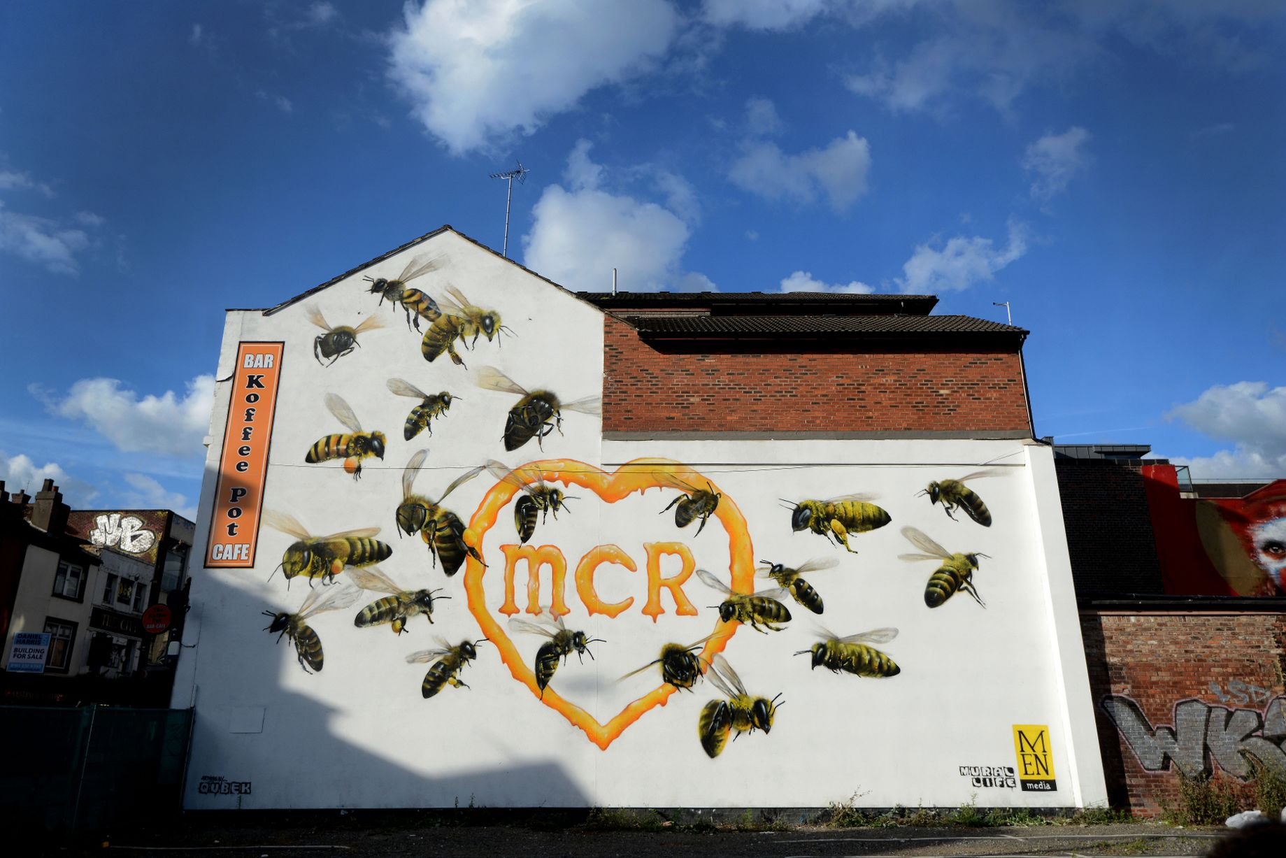 worker bee wall murals prevail through tragedy in manchester bang