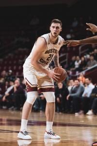 Popavik pivoting with a basketball.
