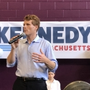 Joe Kennedy standing in front of a Kennedy for Massachusetts sign, announcing his running