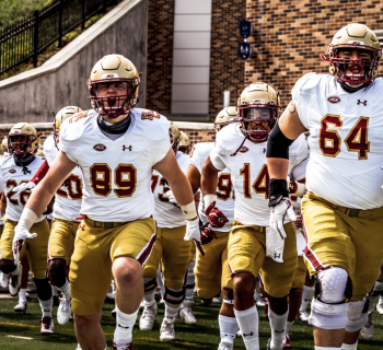 BC football team running onto field