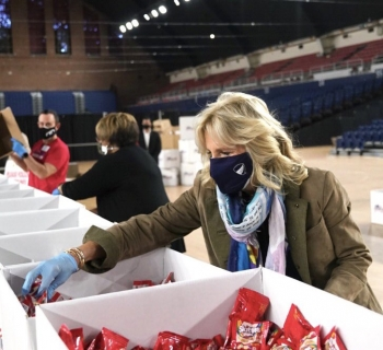 Dr Jill Biden helping in handing out food for the disenfranchised.