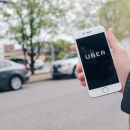 """Photo of a phone reading """"Uber"""""""