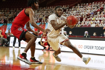 BC Men's Basketball player running around an NC State player, getting ready to make a shot
