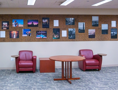 A photo of the exhibit behind two seats and a small table